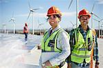 Portrait confident engineers at alternative energy power plant