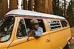 Man driving camper van, Sequoia National Park, California, USA