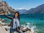 Woman taking selfie at Garda Lake, Malcesine, Veneto, Italy