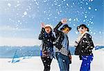 Tourists on Italian alps enjoying snow, Malcesine, Veneto, Italy