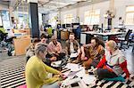 Creative business team meeting, brainstorming on floor in office