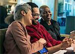 Creative business people using digital tablet