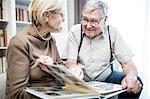 Senior couple looking at photo album.