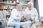 Senior couple reading books.