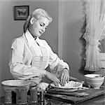 1940s 1950s BLOND WOMAN PREPARING DOUGH MAKING A CRUST TO BAKE A PIE