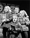 1950s TWO GIRLS TWO BOYS SINGING CHRISTMAS CAROLS