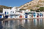 Colourful fishermen's boat houses with Plaka on hill, Klima, Milos, Cyclades, Aegean Sea, Greek Islands, Greece, Europe