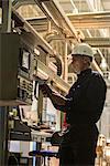 Factory worker using digital tablet in factory