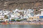 People enjoying the beach at Puerto de Mogan, Gran Canaria, Canary Islands, Spain, Atlantic, Europe