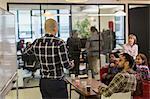 Creative business people brainstorming in office meeting