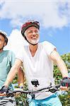 Portrait confident mature man mountain biking