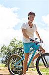Portrait smiling, confident mature man mountain biking