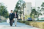 Japanese couple walking to work