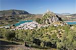 Moorish castle above white village with olive groves, Zahara de la Sierra, Sierra de Grazalema Natural Park, Andalucia, Spain, Europe