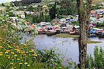 Palafitos, colourful stilt houses on water's edge, elevated view, unique to Chiloe, Castro, Isla Grande de Chiloe, Chile, South America