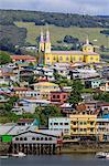 Castro, from the sea, Iglesia San Francisco de Castro, UNESCO World Heritage Site, and palafitos, Isla Grande de Chiloe, Chile, South America