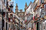 Church overlooking Semana santa decoration on buildings, Olvera, Andalucia, Spain, Europe