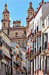 Church overlooking Semana Santa decorations on buildings, Olvera, Andalucia, Spain, Europe