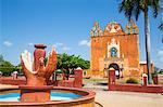 Hands Fountain in foreground, Church of San Antonio de Padua in background, Ticul, Yucatan, Mexico, North America