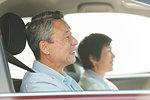 Japanese senior couple driving