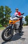 Woman posing on her adventure motorcycle, Nan, Thailand