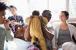 Happy multi-ethnic family on sofa