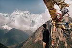 Hiker on peak, Annapurna Circuit,  view to Annapurna 2 mountain, the Himalayas, Manang, Nepal