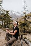 Hiker taking break on trail, Annapurna Circuit in Muktinath, the Himalayas, Nepal