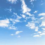 Scant clouds in blue sky