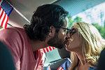 Couple kissing inside vehicle