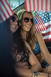Women smiling inside vehicle