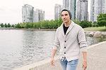 Young man walking along seawall, Yaletown, Vancouver, Canada