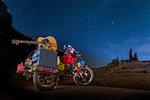 Motorcycle on rock climbing route, Canyonlands National Park, Moab, Utah, USA