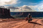 Biker on rock climbing route, Canyonlands National Park, Moab, Utah, USA