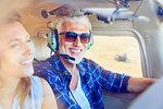 Smiling pilot flying airplane