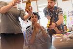 Creative designers examining bottles in office