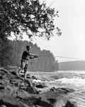 1920s MAN SPORTSMAN CASTING FLY FISHING IN WILDERNESS STREAM BRITISH COLUMBIA CANADA