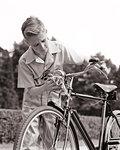 1940s BLOND YOUNG TEENAGE BOY POLISHING HEADLIGHT ON EXPENSIVE ENGLISH BICYCLE