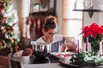 Girl icing christmas cookies