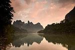 Sunrise reflected in the Li River, Guilin, China, Asia