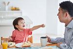 Japanese kid having breakfast