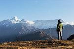 Solo female traveler looking at majestic mountain view, Jaikuni, Indian Himalayan Foothills