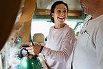 Couple making tea in motor home