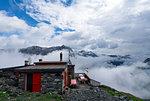 Clouds around Del Grande Camerini refuge , Chiareggio, Valmalenco, Province of Sondrio, Lombardy, Italy