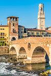 Ponte Pietra (Stone Bridge) and Verona old town at sunrise. Verona, Veneto, Italy