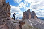 A photographer at Passaporto Fork, Dolomites, Auronzo di Cadore, Belluno, Veneto, Italy