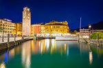 Torre Apponale and Piazza 3 Novembre at dusk. Riva del Garda, Garda Lake, Trento province, Trentino Alto Adige, Italy, Europe.