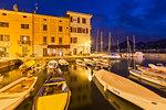 Twilight at the harbour of Castelletto, Brenzone sul Garda, Garda Lake, Verona province, Veneto, Italy, Europe.