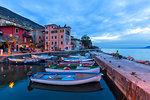 Twilight at the little harbour of Macugnano, Brenzone sul Garda, Garda Lake, Verona province, Veneto, Italy, Europe.