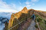 Woman walking on PR1 trail. Pico do Arieiro, Funchal, Madeira region, Portugal.